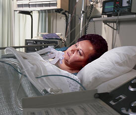 Obese woman in hospital bed
