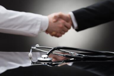 Business man and doctor making a deal