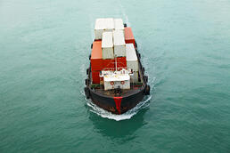Container ship with foreign fabrics
