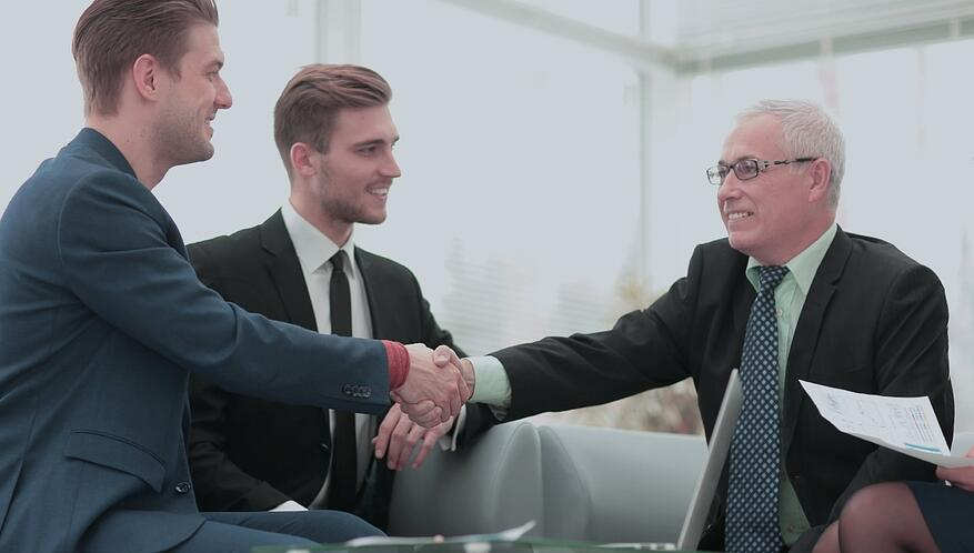 Purchase manager and employee shaking hands