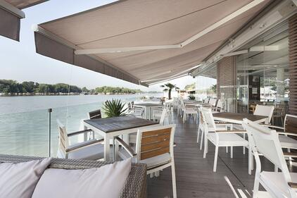 Restaurant tables covered by awnings