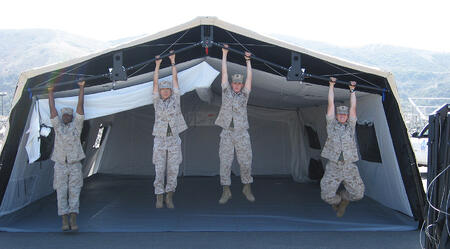 Soldiers hanging on a tent.