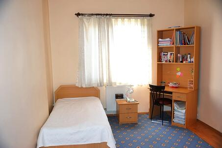College dorm room with a bed covered with antimicrobial fabric