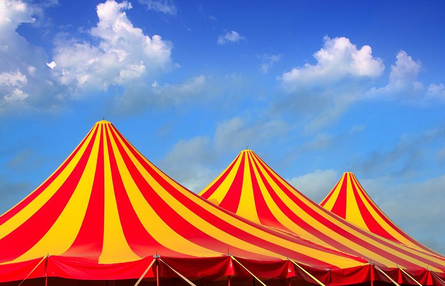 Carnival tents with blue sky in the background